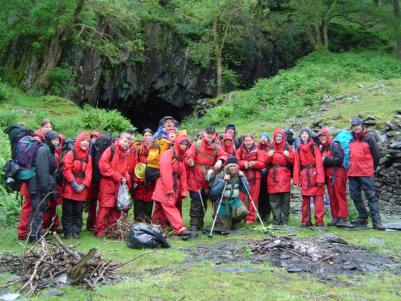 young-people-ready-to-move-off-after-a-night-in-Millican-Dalton's-cave,-Borrowdale
